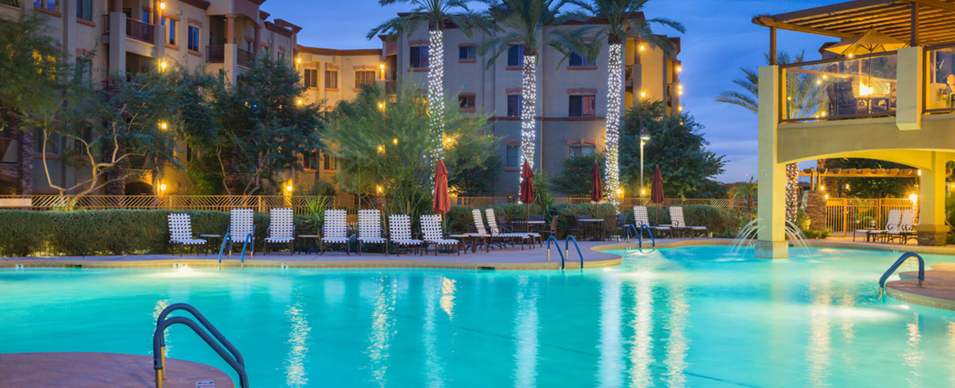 Phoenix Condos - picture of outdoor pool and pretty lighting at Toscana of Desert Ridge