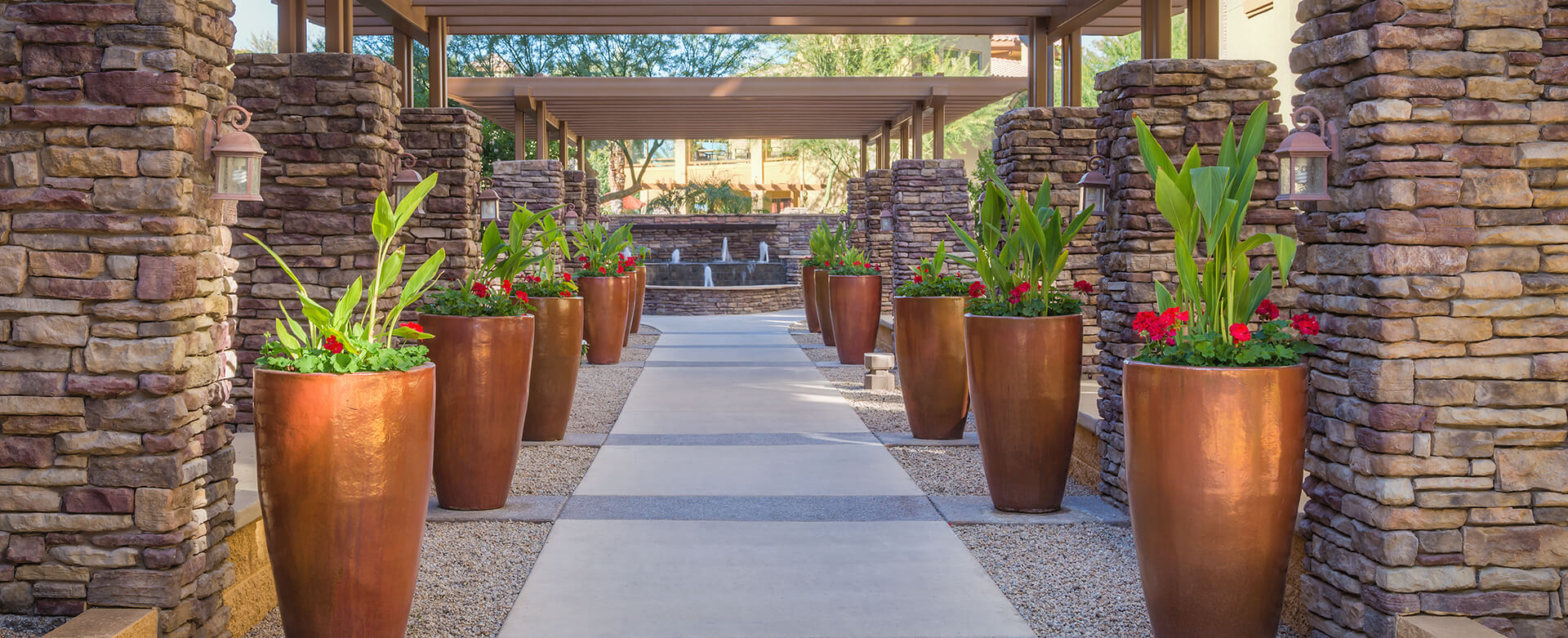 Phoenix Condos - picture of outdoor alleyway with view of water fountain at Toscana of Desert Ridge